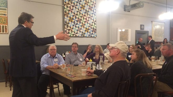 Former Texas Gov. Rick Perry speaks Wednesday at Winterset's Northside Cafe. He later spoke at a forum on national security in Des Moines.