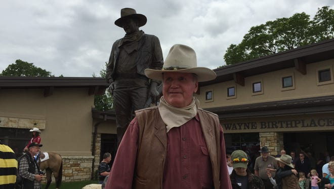 Greg Miller dresses up as the John Wayne movie character Big Jake on Saturday in celebration of the grand opening of the John Wayne Birthplace Museum in Winterset.