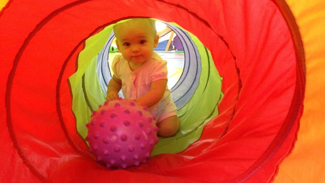 Isabella plays at Gymboree after taking a nice nap in the car on the way to class.