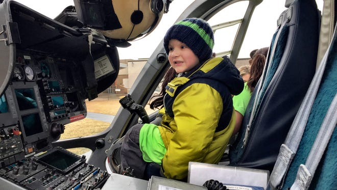 Kyler Streib, 5, sits inside a Mercy Flight helicopter on Wednesday at Benefis Health System.