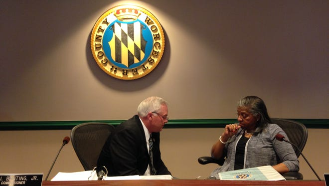 Worcester County Commissioners Jim Bunting and Diana Purnell talk after the board's March 17 meeting.