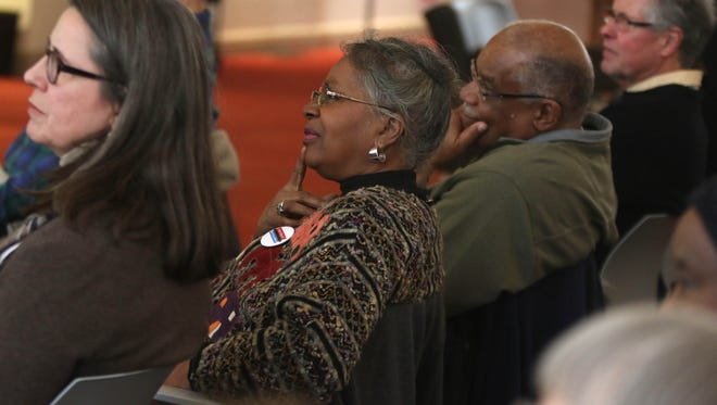 Attendees listen to guest speaker Jeffrey B. Perry discuss race during an event at the Wilmington Library on Friday.