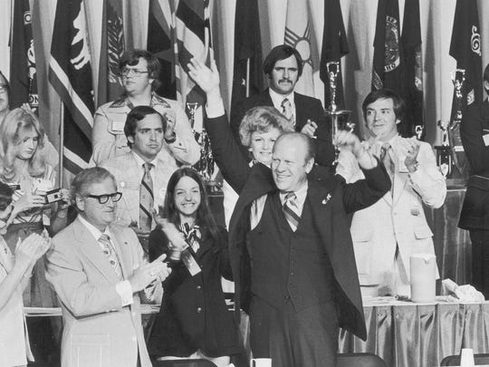 President Gerald Ford waves as he acknowledges applause at the National Jaycees Convention in the Expo Center June 22, 1976.  At left is Gov. Otis Bowen.