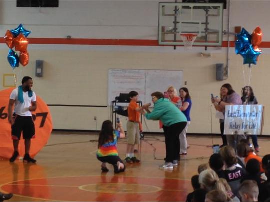 East Elementary Principal Judy Record kisses a bearded