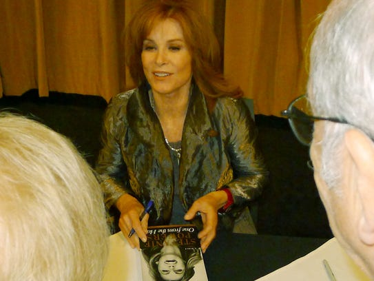 "Actress Stefanie Powers signs her autobiography, ""One"