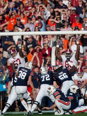 Auburn place kicker Daniel Carlson (38) kicks a field goal during the first half of the NCAA college football game between Auburn vs. Alabama, Saturday, Nov. 28, 2015, at Jordan-Hare Stadium in Auburn, Ala.