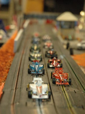 The Wauwatosa Indy Slot Car League members race on member Jon Wyatt's track.