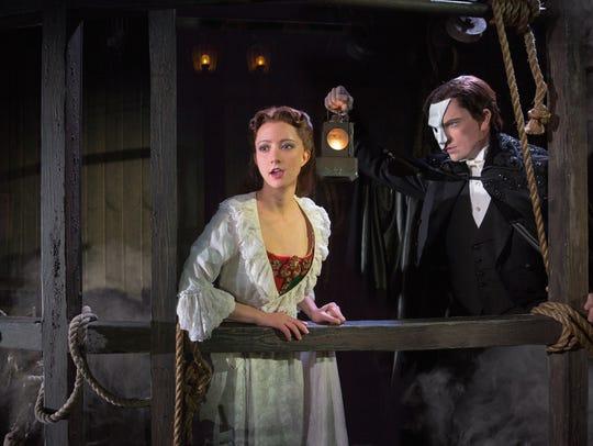 Katie Travis as Christine and Chris Mann as The Phantom