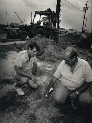 Claude V. D'Unger (left) and Skip Kennedy, both of the Nueces County Historical Commission, mark a spot to investigate for possible artifacts from the old Spohn Hospital on North Beach near the site of the proposed Texas State Aquarium on July 12, 1988.