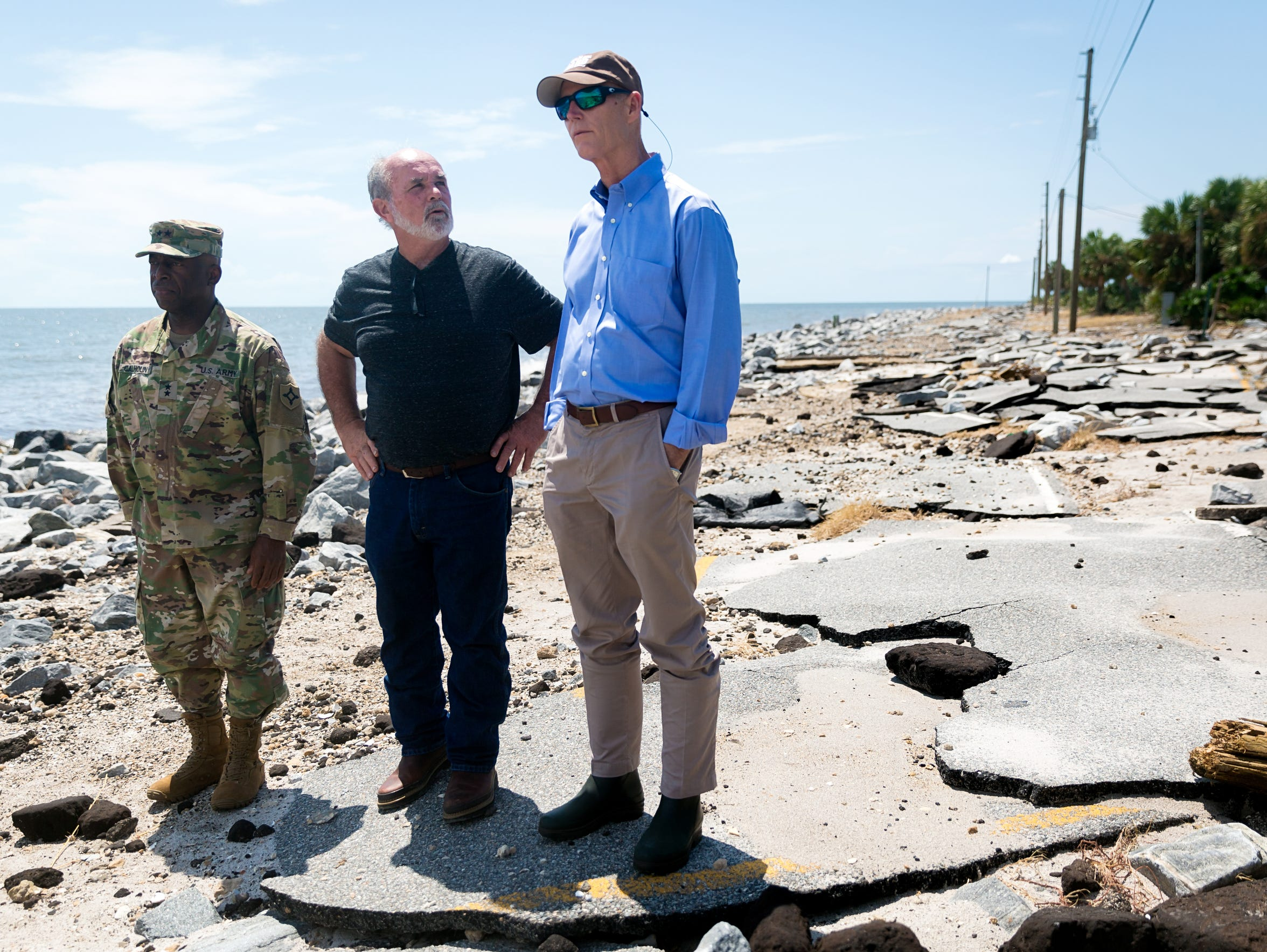 Florida Gov. Rick Scott, right, surveys Hurricane Hermine