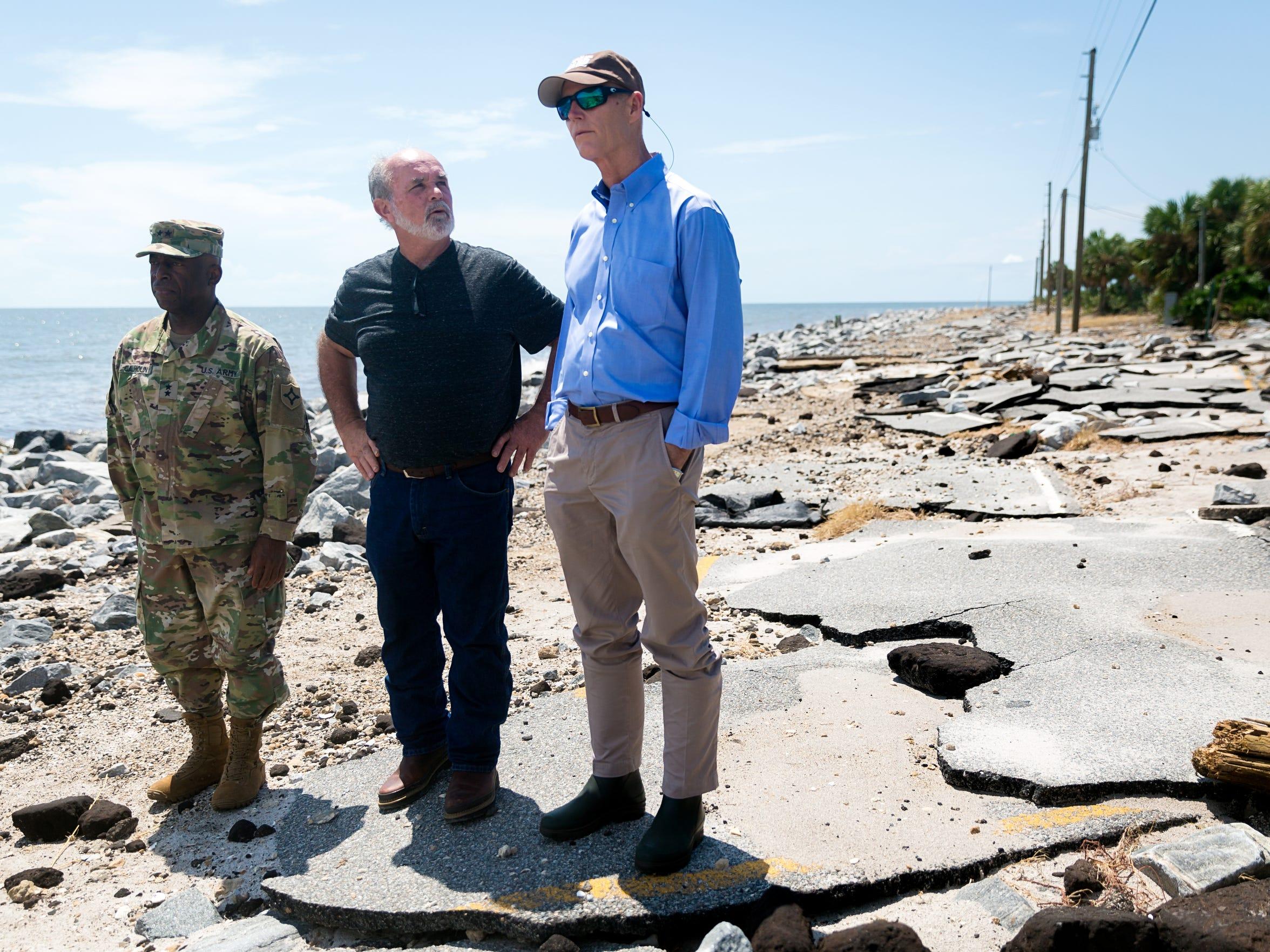Florida Gov. Rick Scott, right, surveys Hurricane Hermine