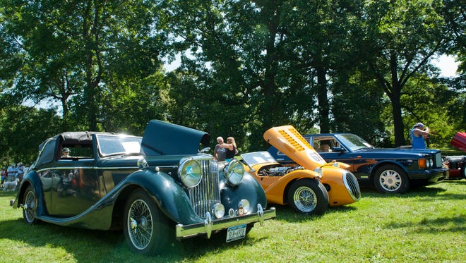 The Greater Rochester Triumph Touring Club and the Webster Lions Club hosted UK Car Day on Sunday at Genesee Valley Park. The festival featured concourse and popular choice judging, special awards, door prizes, entertainment, food and beverages, and professional car photography.