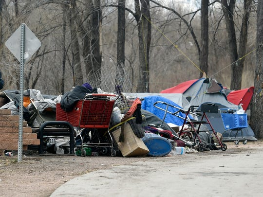This Dec. 12, 2017, photo shows a homeless camp in Colorado Springs, Colo. (Jerilee Bennett/The Gazette via AP)