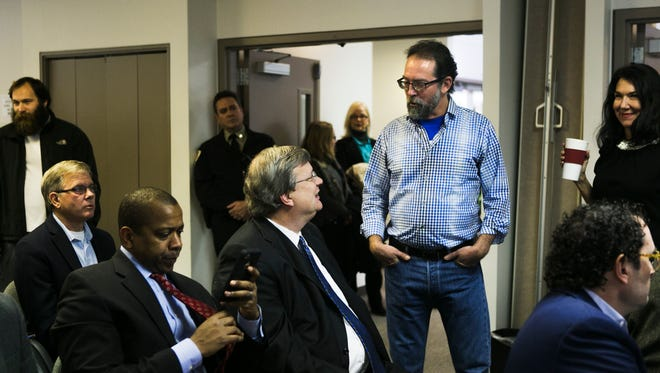November 30, 2016 - Scott Banbury (standing), a conservation program coordinator for the Tennessee Chapter of the Sierra Club, talks with Mayor Jim Strickland prior to a hearing at the Office of Construction Code Enforcement on Wednesday.