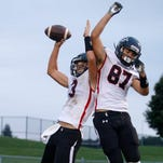 St. Johns' Jack Bouck, left, and Hayden Dyer celebrate Bouck's touchdown against Waverly Sept. 23, 2016, at Waverly High School. St. Johns won 54-21.