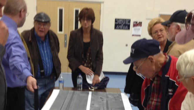 Silver Springs residents look at a conceptual design of the stretch of U.S. 50 that will be widened as part of the USA Parkway project and includes a roundabout at the intersection with U.S. 95A.