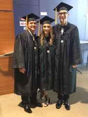 The Cromer triplets at graduation, from left, Brady, Grace and Austin.
