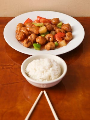 Sweet and Sour Crispy Soy from Zen Garden, $10.95, has soybeans, tomatoes, green peppers, pineapple, vinegar and lemon juicee with sugar. Served with steamed rice.