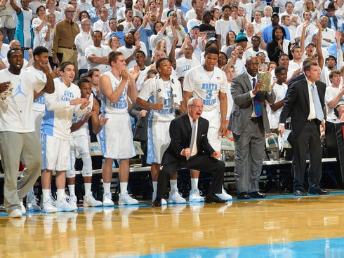 North Carolina Tar Heels bench including head coach Roy Williams reacts in the first half at Dean E. Smith Student Activities Center.