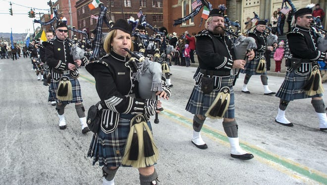 The B.C. Celtic Pipes & Drums march Saturday past St. Mary of Assumption on Court Street in the 47th annual St. Patrick?s Day Parade in downtown Binghamton.  KRISTOPHER RADDER / Staff Photo The B.C. Celtic Pipes & Drums march past St. Mary of Assumption on Court Street in the 47th annual St. Patrick's Day Parade in downtown Binghamton on Saturday.