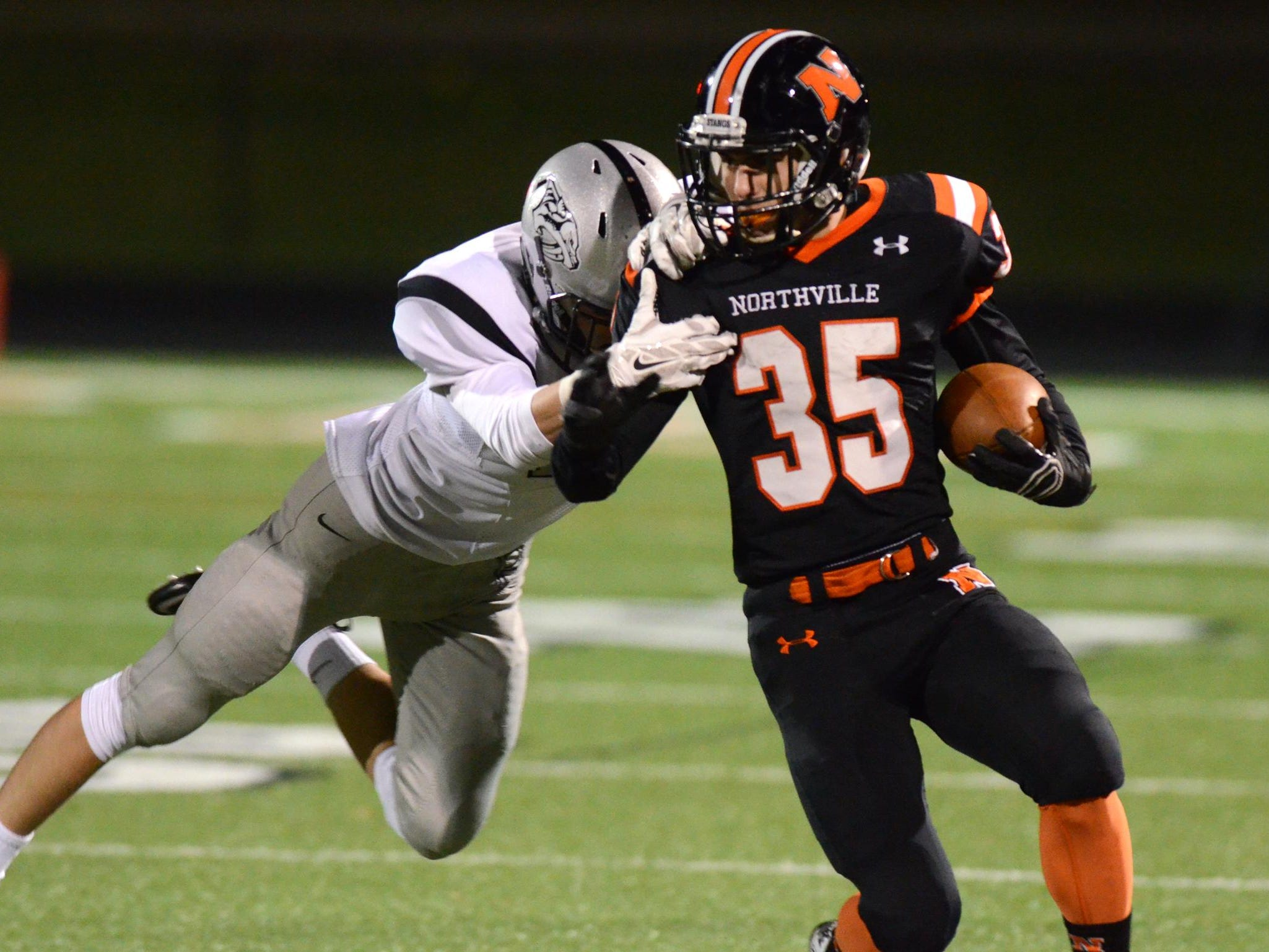 Plymouth's Joey Ahearn (left) closes in on Northville's Adam Ghabra.