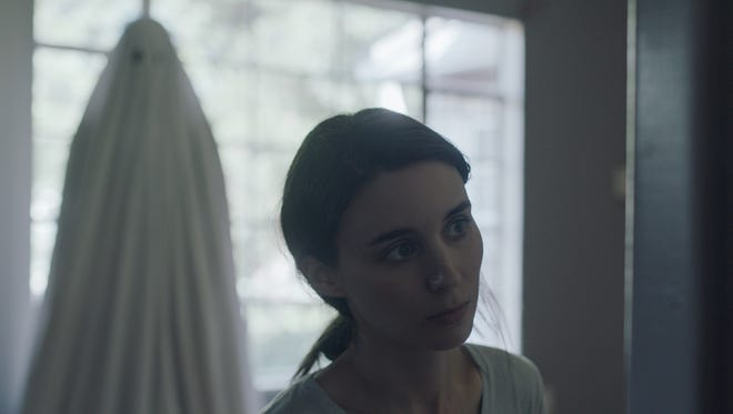 """In """"A Ghost Story,"""" the ghost of a man (Casey Affleck) watches his partner (Rooney Mara) grieve."""