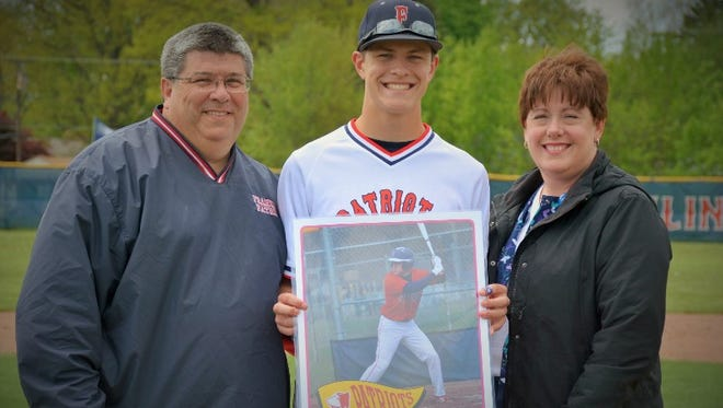 """Last spring, Livonia Franklin baseball player Joe Chinavare was able to celebrate """"Senior Day"""" with his parents, Tom and Sue Chinavare of Westland. Tom Chinavare died Nov. 26 at age 52."""