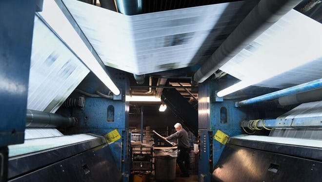 Newspapers are printed at the Courier & Press at 300 E. Walnut St. in Evansville.