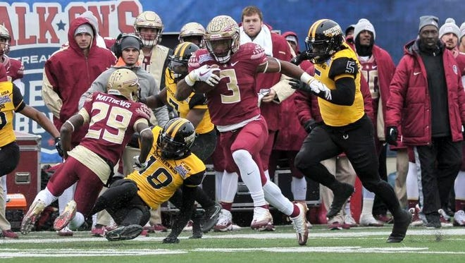 lorida State Seminoles running back Cam Akers (3) carries the ball during the first half against Southern Miss Golden Eagles defensive back Walden Davis (5) during the first half in the 2017 Independence Bowl at Independence Stadium.
