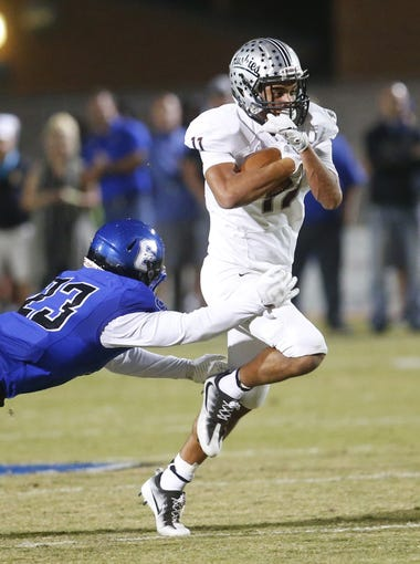 Chandler's Bryce Jackson (23) attempts to tackle Hamilton's Mo Parson (11) during a high school football game at Chandler High on October 27, 2017. #hsfb Chandler vs. Hamilton