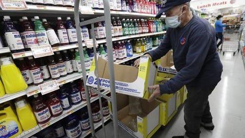 Juan Santos stocks shelves at the Presidente Supermarket in the Little Havana neighborhood of Miami on Wednesday, June 3.