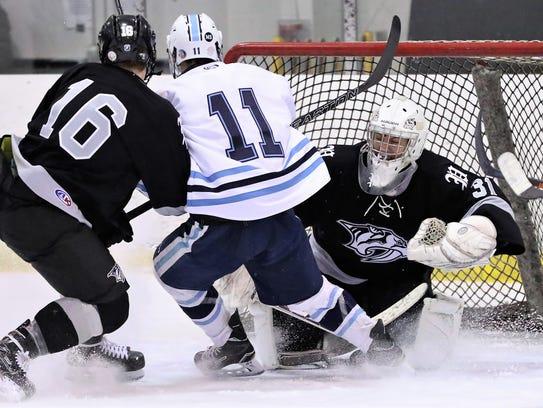 Plymouth goalie Josh Montroy stops Livonia Stevenson's