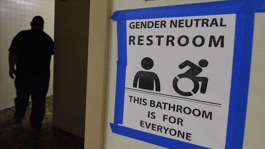 Signs are posted May 4, 2016, outside Santee High School's gender-neutral restrooms at its campus in Los Angeles.