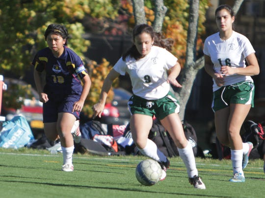 Solomon Schechter's Reese Cohen dribbles the ball upfield during a Section 1, Class C quarterfinal game at Keio Academy on Monday, October 26th, 2015. Solomon Schechter won 9-2.