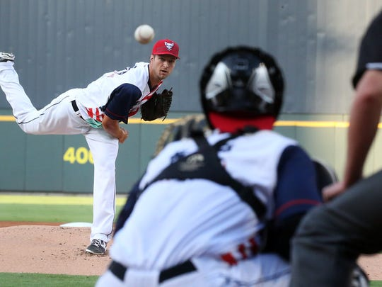 Then-El Paso Chihuahuas right-hander Colin Rea fires away against the Fresno Grizzlies in a game at Southwest University Park.