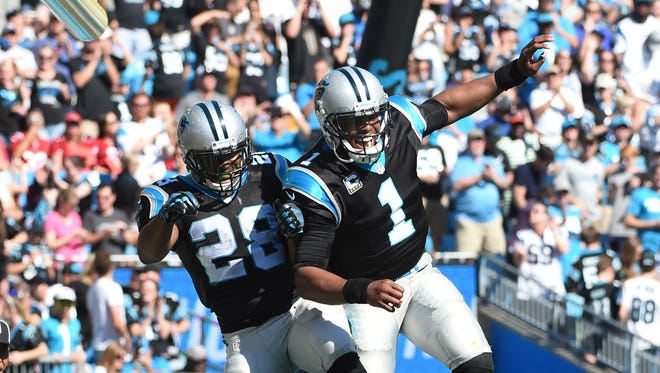 Jonathan Stewart (28), Cam Newton (1) and the Panthers got their first win since Week 2.