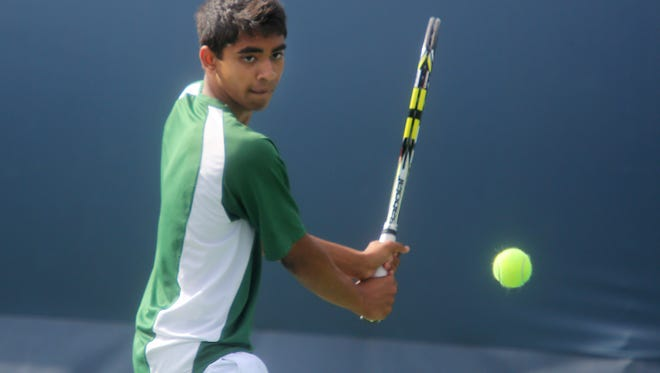 Sycamore's Deepak Indrakanti prepares to hit the ball during the Divisions I and II district tennis tournaments in May of 2014.