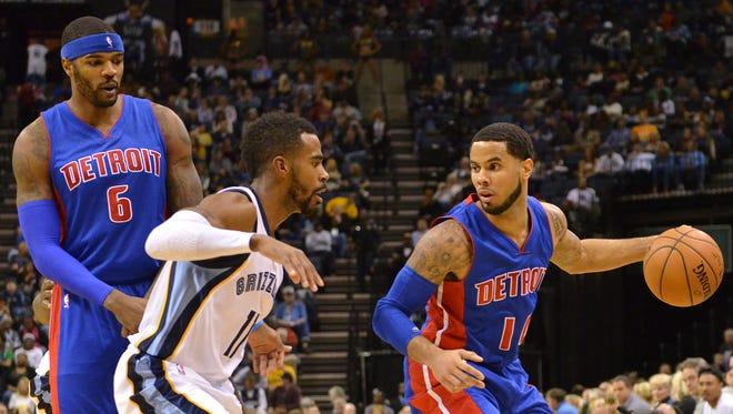 Detroit Pistons guard D.J. Augustin, right, plays against the Memphis Grizzlies on Nov. 15, 2014.