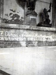 "Scrawled on the wall: ""I am ashamed I am a German,"""