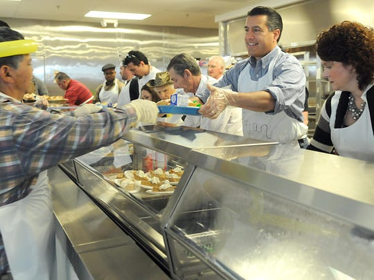 Vincent Yowell, seen here volunteering with Gov. Brian Sandoval at St. Vincent's Dining Room on Thanksgiving 2011, was killed crossing North Virginia Street on Dec. 22. Sandoval sits on the state board that decides which road projects to fund.