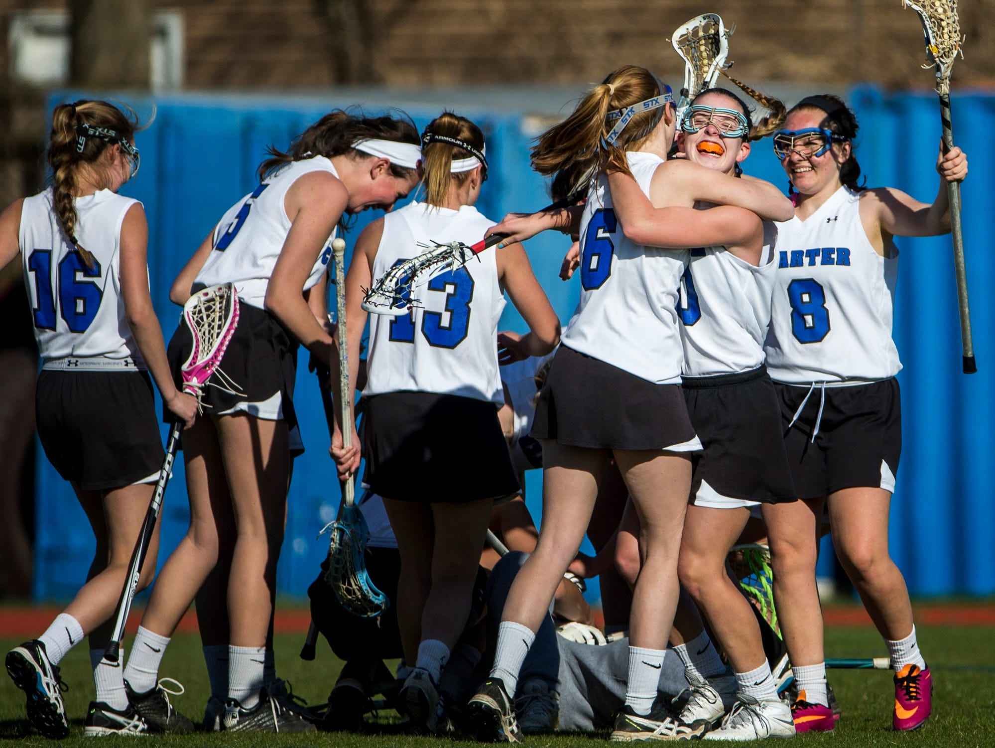 Charter players celebrate after defeating Tower Hill 10-9 win at Charter School of Wilmington on Tuesday afternoon.