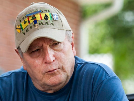 Dennis Nazorek discusses his experiences in Vietnam at a friend's home in New Castle on Thursday afternoon.