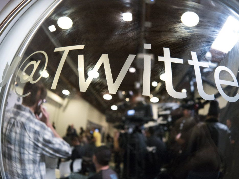 This April 7, 2015 file photo shows people as they wait for a press conference at tech company Twitter's office space in Santa Monica, California.