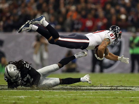 MEXICO CITY, MEXICO - NOVEMBER 21:   C.J. Fiedorowicz #87 of the Houston Texans is tackled by Reggie Nelson #27 of the Oakland Raiders in their game at Estadio Azteca on November 21, 2016 in Mexico City, Mexico.  (Photo by Buda Mendes/Getty Images)