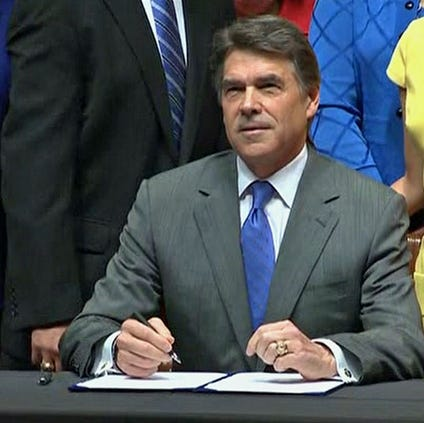 As protesters chanted in the rotunda of the state Capitol on July 18, 2013, Texas Gov. Rick Perry signed into law sweeping new abortion restrictions that sparked weeks of protests.
