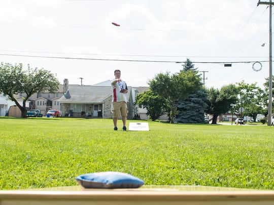 Mike Rabine plays a round of cornhole at Moul Field in Hanover Borough on June 7, 2018. The York Adams Cornhole league will host the Pennsylvania State Championships of Cornhole at the Heritage Hills Athletic Club in York.