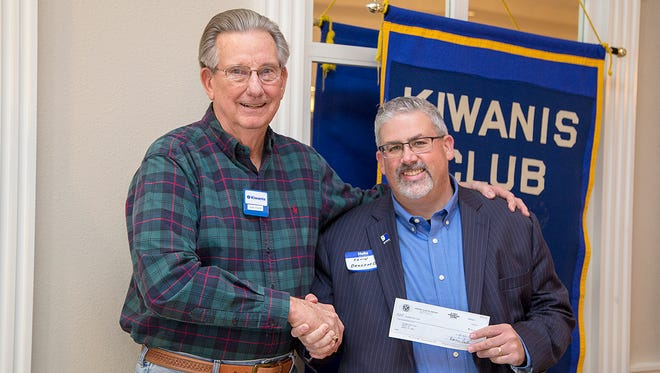 Don Paige (left), of the Kiwanis Club of Abilene, presents a donation to Kevin Bradford, president and CEO of Goodwill West Texas.