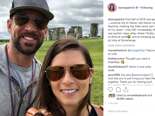 Danica Patrick got Aaron Rodgers to wear a Santa hat and decorate stockings