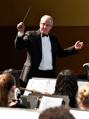Abilene High School band director Paul Walker leads the honor band during Tuesday night's spring concert in the AHS auditorium. Walker is retiring after 28 years as a band instructor, 21 of them at Abilene High.