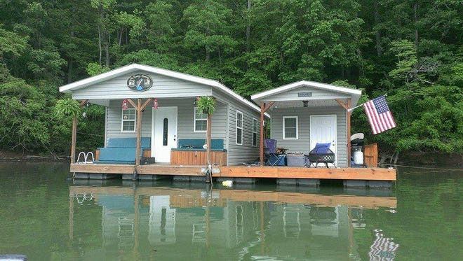 The Lane family's floating houseboat on Fontana Lake would be one of hundreds forced to be removed if a TVA proposal passes this week.
